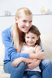 Smiley mum with her daughter Stock Photos