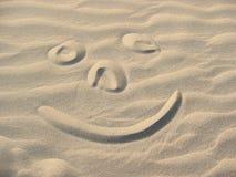 Smiley na areia Fotografia de Stock