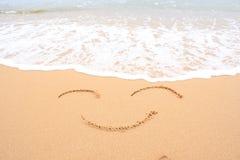 Smiley na areia Foto de Stock Royalty Free