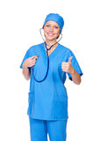 Smiley nurse listening her heart Royalty Free Stock Images