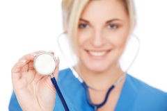 Smiley nurse with stethoscope Royalty Free Stock Images