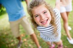 Smiley och lycklig flicka Arkivbild