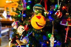 Smiley ornament on a Christmas tree royalty free stock photography
