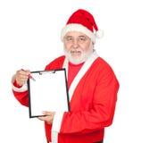 Smiley Papai Noel com uma prancheta em branco Imagem de Stock