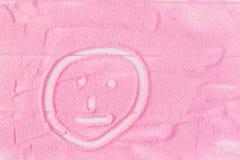 Smiley peint sur le sable décoratif sur la table Photos stock