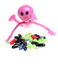 Smiley and pills. Pink smiley figure in front of pills heap Stock Image
