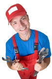 Smiley repairman with spanners Royalty Free Stock Photography