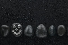 Smiley of rhinestones on a black stone Stock Photos