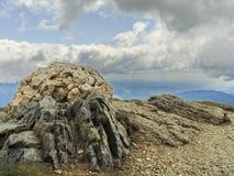 Smiley Rock - Sinaia, Cota 2000. This is an old picture taken with compact camera at Sinaia, Romania (The Bucegi Mountains, Cota 2000). I found this smiley rock royalty free stock photos