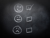 Smiley or Sad Checkboxes on Blackboard. Smiley or Sad draw Checkboxes on Blackboard Stock Photo