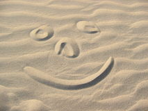 Smiley in the sand. Smiley face written in sand Stock Photography