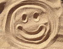 Smiley Sand Face Arkivbild