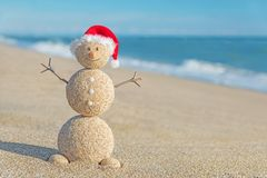 Smiley sandy snowman in santa hat. Holiday concept for New Years Stock Photography