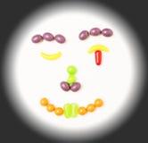 Smiley, sbattente le palpebre il fronte della caramella. Immagine Stock
