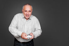 Smiley senior man with joystick Royalty Free Stock Photo