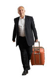 Smiley senior man with suitcase Royalty Free Stock Image