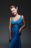 Smiley and woman in blue dress Stock Photography