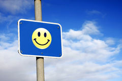 Smiley sign against a blue sky Royalty Free Stock Images