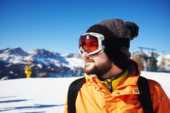 Smiley skier in orange jacket and mask Royalty Free Stock Images