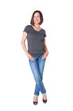 Smiley slim girl in the t-shirt and jeans Royalty Free Stock Photography