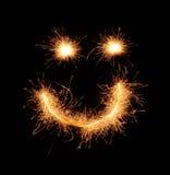 Smiley sonriente extraño feliz dibujado con las chispas en fondo negro Imagen de archivo
