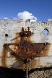 Smiley stern. The rusting stern of an old abandoned wooden fishing boat forms a smiley face Stock Photos