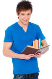 Smiley student with books. Portrait of smiley student with books over white background Royalty Free Stock Photos