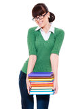 Smiley student holding books Royalty Free Stock Photos