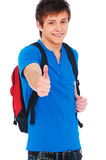 Smiley student showing thumbs up. Portrait of smiley student showing thumbs up over white background Stock Photography