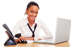 Smiley student on the workplace Stock Photo