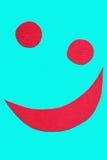 Smiley su tessuto rosso Fotografia Stock