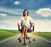 Smiley successful businesswoman sitting Stock Photography
