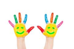 Smiley sur des mains, amis, joie, concept d'amusement Images stock