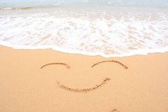 Smiley sur le sable Photo libre de droits