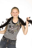 Smiley teen. Teen looking at the camera with a feather boa Stock Photos