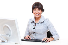 Smiley telephone operator at workplace Royalty Free Stock Photography