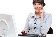 Smiley telephone operator at workplace Stock Photography