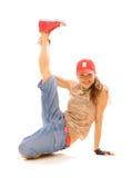 Smiley tomboy holding her leg stock photography