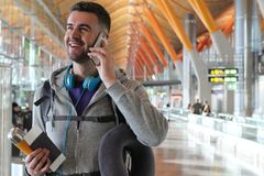 Smiley traveler calling by phone.  Stock Photos