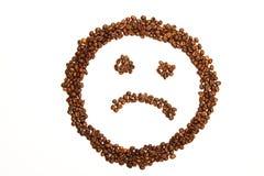 Smiley triste feito de feijões de café foto de stock royalty free