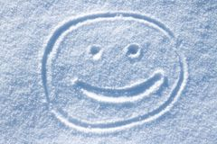 Smiley twarz w śniegu fotografia royalty free