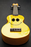 Smiley ukulele Royalty Free Stock Photos