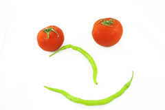 Smiley vegetables. With tomatoes and paprikas Stock Photos