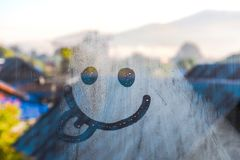 Smiley Water Drop on window and cold weather in morning stock photography