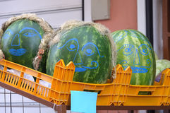 Smiley watermelons. On a street market Royalty Free Stock Photography