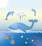 Smiley whale. A whale and two dolphins are playing at sea. Colorful tropical fishes are swimming underneath. From KidColors series Stock Image