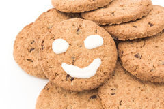 Smiley on whole wheat biscuits Royalty Free Stock Images