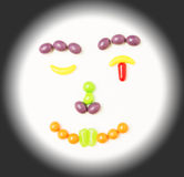 Smiley, winking candy face. Stock Image