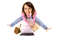 Smiley woman with books and laptop Stock Images