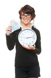 Smiley woman with clock and money. Studio picture of smiley woman with clock and money. isolated on white Royalty Free Stock Photography